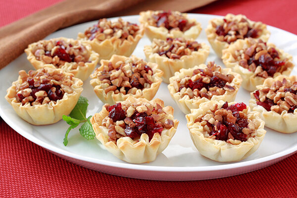 "Hungry Girl's Savory Cranberry & Cheese Bites - ""Mini fillo shells are such a timesaver during the busy holiday season. You can find them in the freezer aisle, and they heat up in minutes. This 15-minute recipe is perfect for easy holiday entertaining…"" - Lisa Lillien of Hungry Girl"